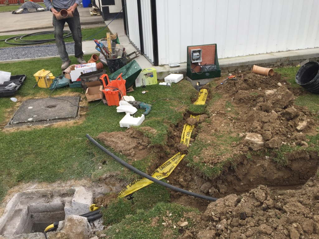 Laying the pipework, power lines and control unit for the Bio Pure system.