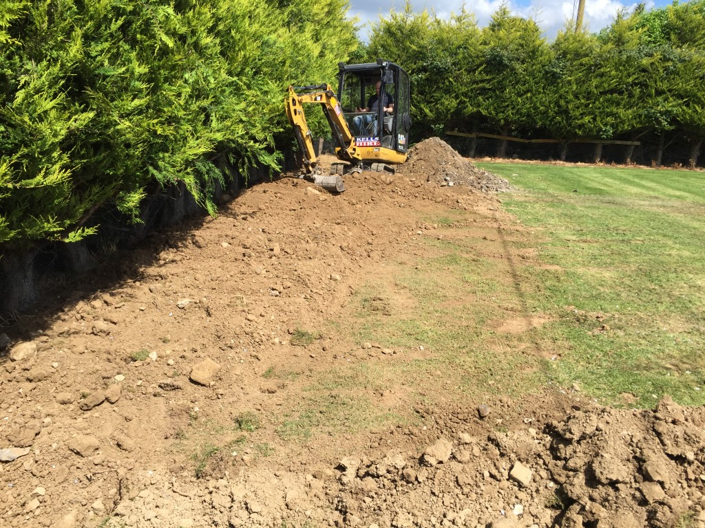 Backfilling and landscaping to finish the installation